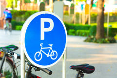 Bicycle parking sign in public park. Royalty Free Stock Photography