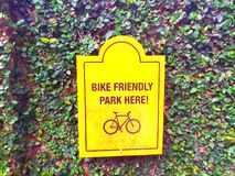 Bicycle parking symbol on green leaf background stock images