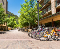 Bicycle parking in touristic town. Mountain and blue sky on background stock photography