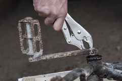 Bicycle parts, Mechanic reiparing a bike, chainring and pedals Stock Image