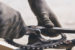 Bicycle parts, Mechanic reiparing a bike, chainring and pedals Royalty Free Stock Photos