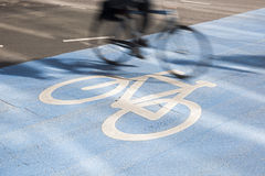 Bicycle pasing by in Copenhagen. Blurred motion. Stock Image