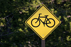 Bicycle path only. Bicycle path sign with blurred forest background Stock Photos
