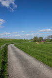 Bicycle path along the dollard route in Ostfriesland Royalty Free Stock Images