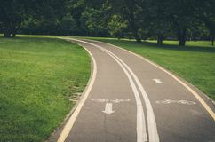 Bicycle path along the park/bicycle path along the park. Toned royalty free stock photo
