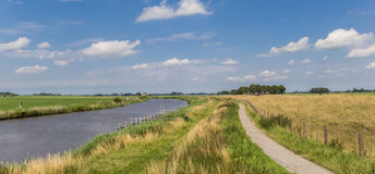 Bicycle path along the Reitdiep river in Groningen. Netherlands Stock Photo