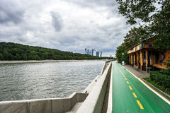 Bicycle path along the river quay. Public park Royalty Free Stock Photography