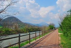 Bicycle path along small river. Royalty Free Stock Photography