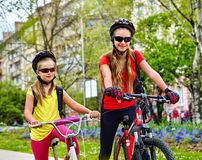 Bicycle path with children. Girls wearing helmet with rucksack . Stock Photos