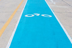 Bicycle path drawn on the asphalt road. Lanes for cyclists. Traffic signs and road safety Royalty Free Stock Images