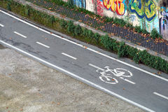 Bicycle path drawn on the asphalt road. Lanes for cyclists. Traffic signs and safety. Cycleway. Bicycle path drawn on the asphalt road. Lanes for cyclists royalty free stock images