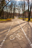 Bicycle path goes through park in Vilnius, Lithuania Royalty Free Stock Photography