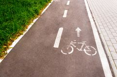 A bicycle path in a public park designed to ensure safety on a bicycle. Toning.  Stock Photos