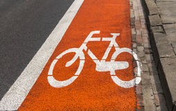 Bicycle path - Red and white road marking on asphalt Royalty Free Stock Photos