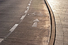 Bicycle path and sidewalk in the sunlight Royalty Free Stock Photo
