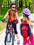 Bicycle path sign with children. Girls wearing helmet with rucksack . Royalty Free Stock Images