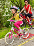 Bicycle path sign with children. Girls wearing helmet with rucksack . Royalty Free Stock Photos