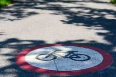 Bicycle path sign on the ground. Photo was taken on a nice sunny day, in city center of Szeged-Hungary Royalty Free Stock Photography