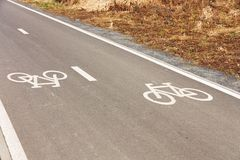 Bicycle path. Two directions bicycle path at a park Stock Photos