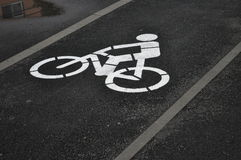 Bicycle path. On wet asphalt Royalty Free Stock Image