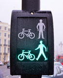 Bicycle, pedestrian crossing lights. Modern lights for pedestrians crossing, bicycle crossing with buildings and traffic in background Stock Photos