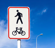 Bicycle and pedestrian lane road sign on pole post, bike cycling Royalty Free Stock Photography
