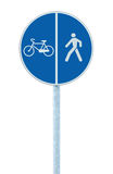 Bicycle and pedestrian lane road sign on pole post, large blue round isolated bike cycling and walking walkway footpath route Royalty Free Stock Images