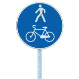 Bicycle and pedestrian lane road sign on pole post, large blue round isolated bike cycling walking walkway footpath trail route Stock Photography