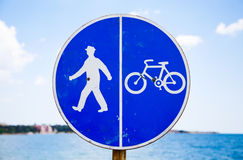 Bicycle and pedestrian lane sign against the sea Stock Image