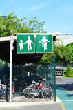 Bicycle and pedestrian shared route sign on green metal signpost Royalty Free Stock Photography