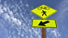 Bicycle and pedestrian sign against blue sky Royalty Free Stock Photography
