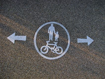 Bicycle and pedestrian sign on the pavement Stock Photography