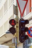 Bicycle and pedestrian traffic light with a red sign on the stre. Bicycle and pedestrian traffic light with a burning red sign on the streets of the city, Munich Stock Image