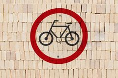 Bicycle permit traffic sign. Stamped on pile of bricks, like a graffiti Stock Photos