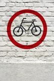 Bicycle permit traffic sign stamped on wall. Bicycle permit traffic sign stamped on white brick wall, like a graffiti Stock Images