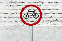 Bicycle permit traffic sign stamped on wall. Bicycle permit traffic sign stamped on white brick wall, like a graffiti Stock Image