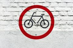 Bicycle permit traffic sign stamped on wall. Bicycle permit traffic sign stamped on white brick wall, like a graffiti Stock Photo