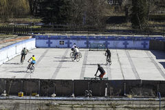 Bicycle Polo. Boys play match in bicycle polo on the old swimming pool Stock Images