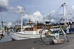 Bicycle in the port of Stockholm. A bycicle standing in a dock in Stockholm Stock Photography