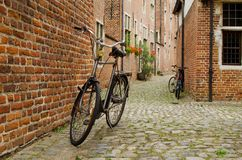 Bicycle is posted on the road in Begijnhof Leuven Royalty Free Stock Image