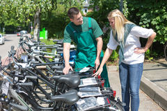 Bicycle presenting new bikes to customer in shop Stock Images