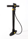 Bicycle pump. Modern, black plastic bicycle tire pump with yellow trim Stock Photo