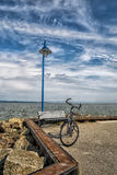 Bicycle on a quay Royalty Free Stock Images
