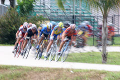 Bicycle Race 173. Cyclists racing around a turn Royalty Free Stock Photography