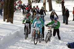 Bicycle race has begun. Russia, St.-Petersburg, March 22: The winter championship of St.-Petersburg on cross-country 2009. Mountain Bike XC race stock image