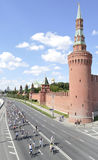 Bicycle race on the Kremlin embankment. General view of a bicycle race on the Kremlin embankment to the background of the Moscow Kremlin Stock Photography