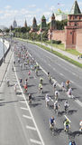 Bicycle race on the Kremlin embankment. General view of a bicycle race on the Kremlin embankment to the background of the Moscow Kremlin Royalty Free Stock Photography