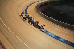 Bicycle race pursuit. Unrecognizable cyclists on race pursuit track Stock Photos