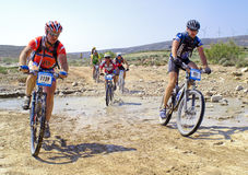 Bicycle race for the semi-desert of  Royalty Free Stock Images