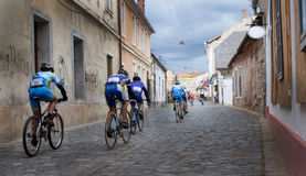 Bicycle race in tight city streets. Group of racers touring the city Royalty Free Stock Images